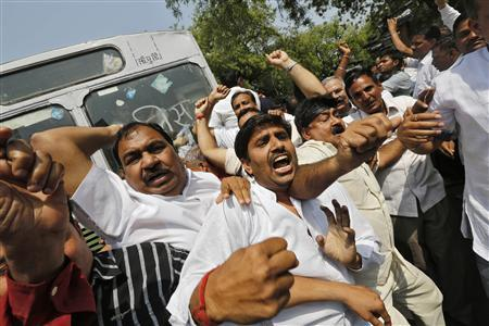Supporters of BJP shout slogans during a protest outside the parliament house in New Delhi